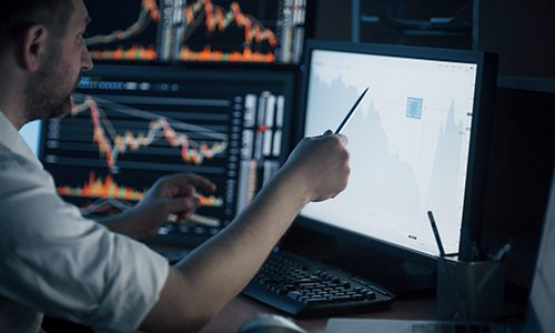 analyzing-data-close-up-of-young-businessman-pointing-on-the-data-presented-in-the-chart-with-pen