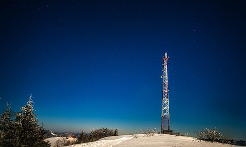 tall-observation-tower-stands-on-a-snowy-hill